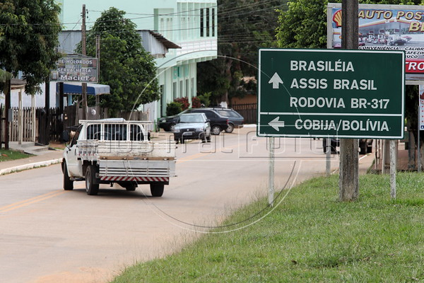 Signs point the way to the Bolivian border in Epitaciolandia - site of an impromptu holding area for Haitian immigtants - in Brazil's Amazonian state of Acre. Hundreds, if not thousands, of Haitians are showing up in Brazil - after an odyssey through Equador, Peru and Bolivia - with hopes of gaining residency as refugees in South America's largest nation. The gymnasium serves as a holding center and shelter until the legal situation of the immigrants is resolved. (Douglas Engle/Australfoto)