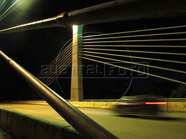 The international bridge connecting the town of Assis Brasil, in Brazil, to Inapari, Peru, in the Amazon. Inapari is a stating area for would-be Haitian immigrants to Brazil. Hundreds, if not thousands, of Haitians are showing up in Brazil - after an odyssey through Equador, Peru and Bolivia - with hopes of gaining residency as refugees in South America's largest nation. (Douglas Engle/Australfoto)
