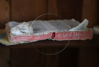 A tattered French-language bible on a shelf in a hotel room of would-be Haitian immigrants to Brazil in the tiny Peruvian town of Inapari, on the border with Brazil. Hundreds, if not thousands, of Haitians are showing up in Brazil - after an odyssey through Equador, Peru and Bolivia - with hopes of gaining residency as refugees in South America's largest nation.  (Douglas Engle/Australfoto)