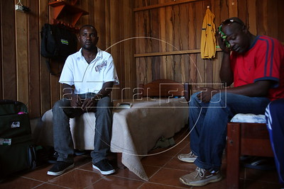 Baptiste Suppler, a would-be Haitian immigrant to Brazil, from Gonaives, Haiti, left, sits in his hotel room with others in the tiny Peruvian town of Inapari, on the border with Brazil - amazingly enough on an street called Brazil Ave. Hundreds, if not thousands, of Haitians are showing up in Brazil - after an odyssey through Equador, Peru and Bolivia - with hopes of gaining residency as refugees in South America's largest nation.  (Douglas Engle/Australfoto)