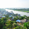 Pevas, Peru, a medium sized village along the Amazon River downstream from Iquitos. Pevas is home to a world famous Amazonian painter and artist named Francisco Grippa. This picture is taken from his gallery and guesthouse that is on the hill overlooking the village.