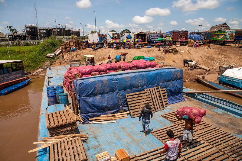 Loading the cargo boats at the Yurimaguas port for journey over the Amazon to Iquitos, Peru
