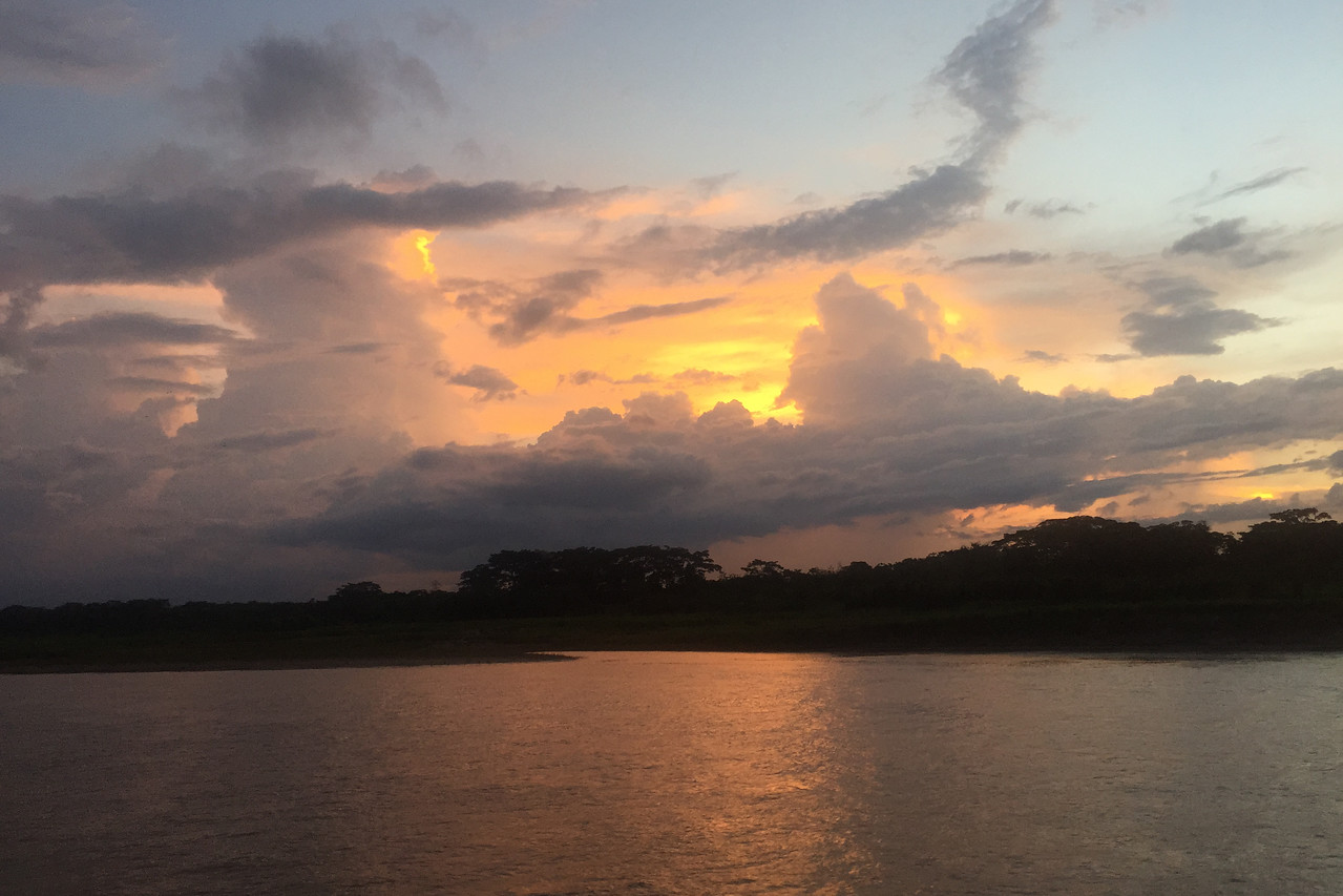 The sun setting over the Amazon, Peru