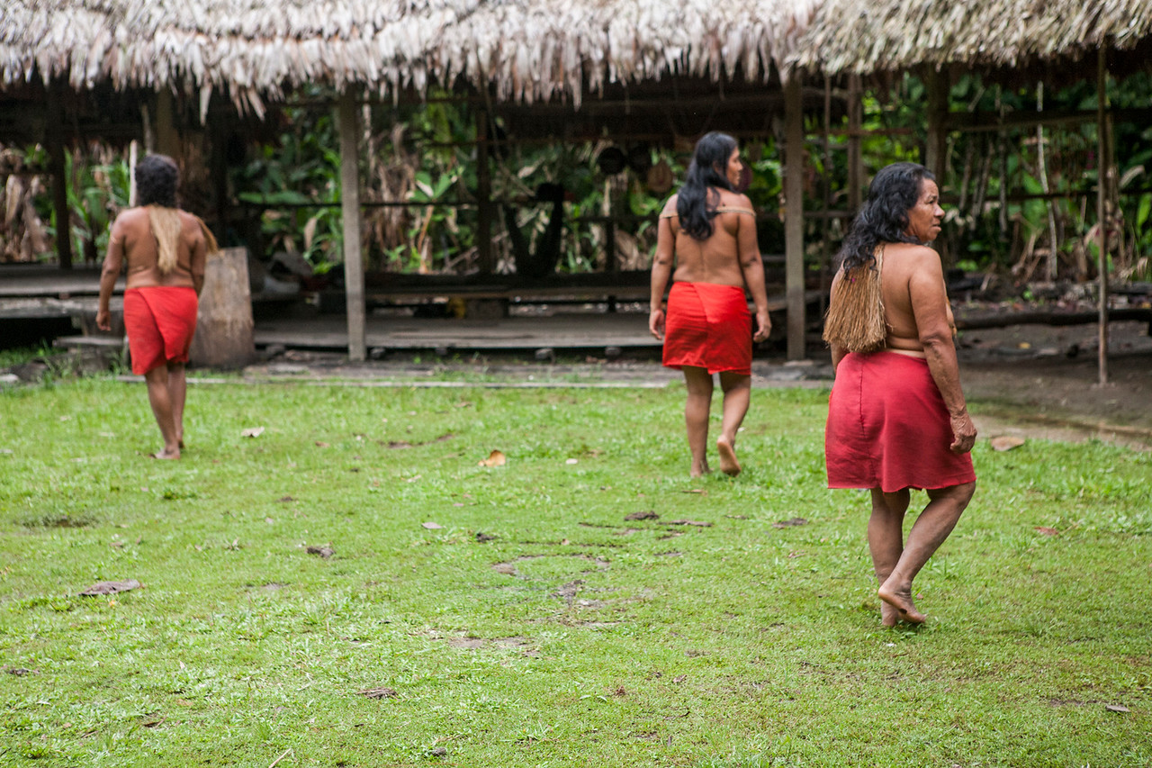 Yagua women walking back to their huts after the performance, Peru