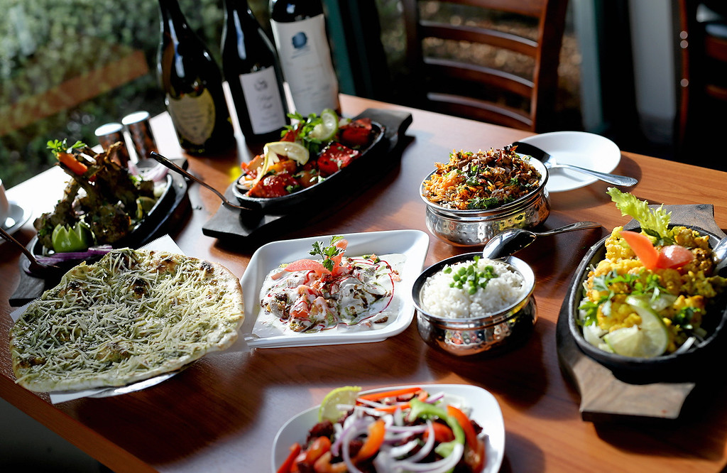 . A colorful feast is laid out on a table inside Ambrosia India Bistro in Scotts Valley on Friday. (Kevin Johnson � Santa Cruz Sentinel)