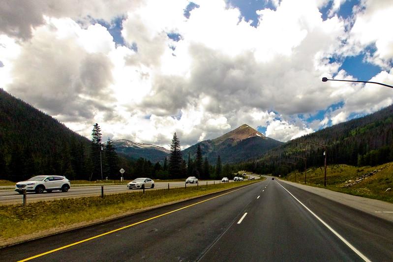Sharp Peak and Bright Clouds