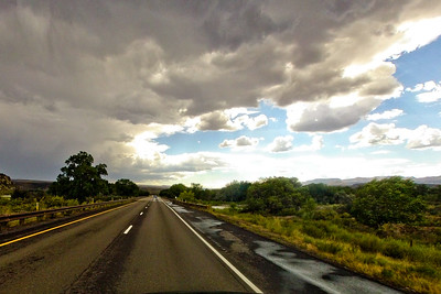 Gray Clouds and Wet Road