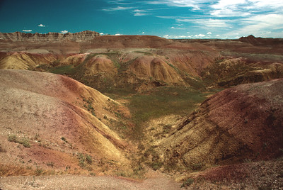 Muddy mountain streams dropped their loads of soil and gravel in the South Dakota Badlands to form a huge flood plain during the Oligocene Epoch 35 million years ago.