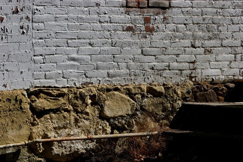 The 19th century stone foundations remain intact.