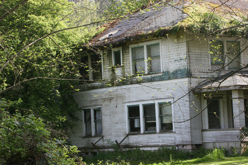 A once proud riverside home waiting for nature or the bulldozer.