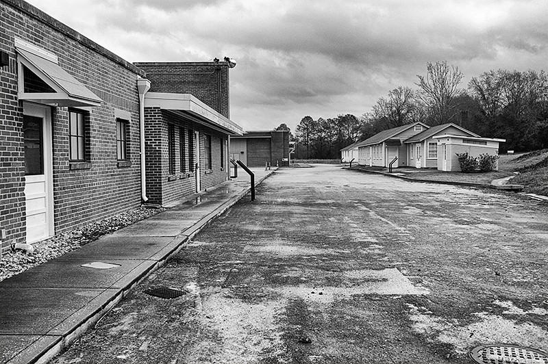 Tuskegee Airmen National Historic Park, Moton Field, walking down to the snack bar on the left in the Hanger #1 building and the Locker Administration Building and Oil Shed on the right