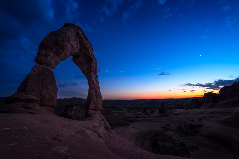 A beautiful fading sunset at Delicate Arch in Arches National Park, Utah