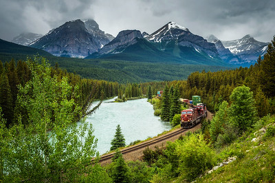 Train passing through Morant's Curve in bow valley, Canada