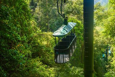 Cable car cabin riding through the tropical rainforest near Jaco in Costa Rica