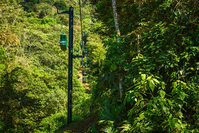 Cable car cabins riding through the tropical rainforest near Jaco in Costa Rica