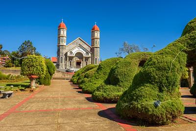 Catholic church with a park in Zarcero, Costa Rica
