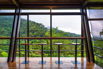 Interior of Celeste Mountain Lodge with views over rainforest in Costa Rica