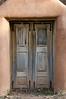 Wooden Doors on Adobe House