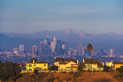 Luxury villas of Los Angeles in California with city skyline in the background