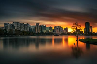 Colorful sunset above Lake Eola and city skyline in Orlando, Florida