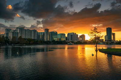 Colorful sunset above Lake Eola and city skyline in Orlando, Florida