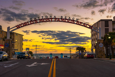 Daytona Beach welcome sign stretched across the street at sunrise