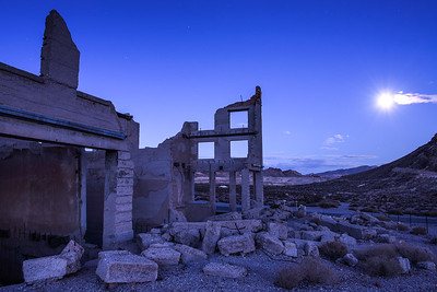 Abandoned building in Rhyolite, Nevada at night with full moon