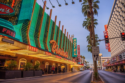 Fremont Street with many neon lights and tourists in Las Vegas