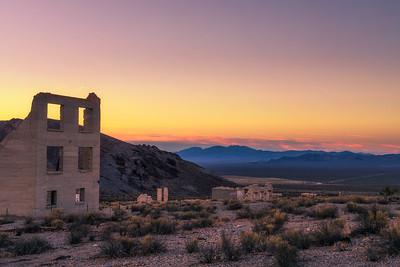 Sunrise above abandoned building in Rhyolite, Nevada