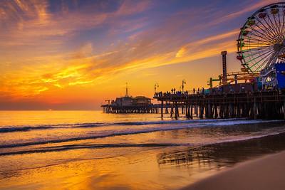 Visitors enjoy sunset above Santa Monica Pier in Los Angeles