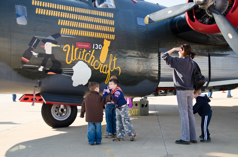 Kids inspecting B24J Liberator heavy bomber at Mckinney TX airport. One of the only planes still flying from WWII. Wings of Freedom tour sponsored by Collings Foundation.