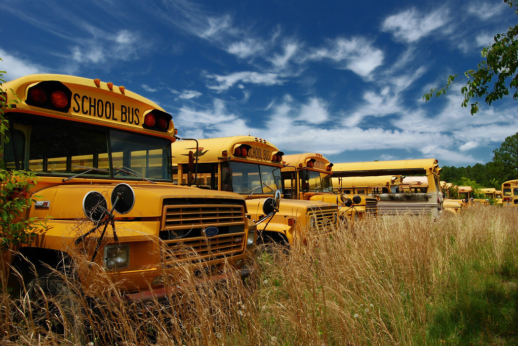 A junkyard filled with school buses on U.S. 441 in Laurens County (GA). May 2008