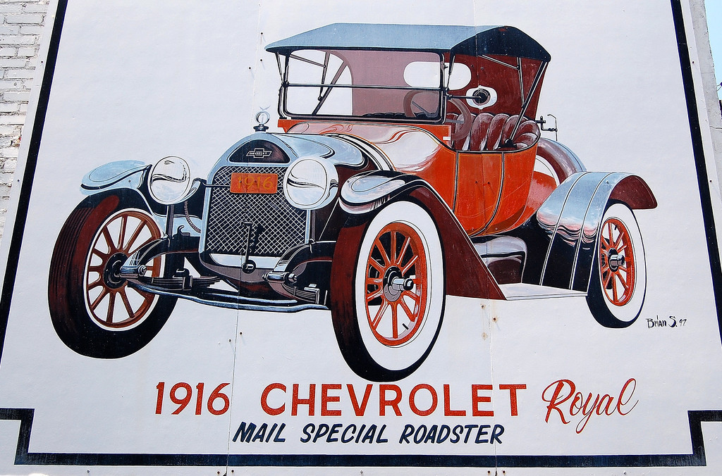 "Old Chevy advertisement in Washington, GA (Wilkes County) 2007<br /> <br /> On sale by June 1915 as a 1916 model, the Chevrolet ""Four-Ninety"" was named for its initial price, $ 490, although, when properly equipped, it cost between $ 550-750. Shortly after its release rival Ford reduced the price of their Model T from $ 490 to $ 440. This in turn prompted Chevrolet to offer the 490 for $ 490 fully equipped, a price it was unable to honor because it was unprofitable. Eventually, over 70,000 of the 490 were built and it became one of the most popular cars of the time.<br /> <br /> Like the Ford Model T, the Chevrolet 490 series was offered in black, black and black; however, the Royal Mail Special obviously had a different color scheme."