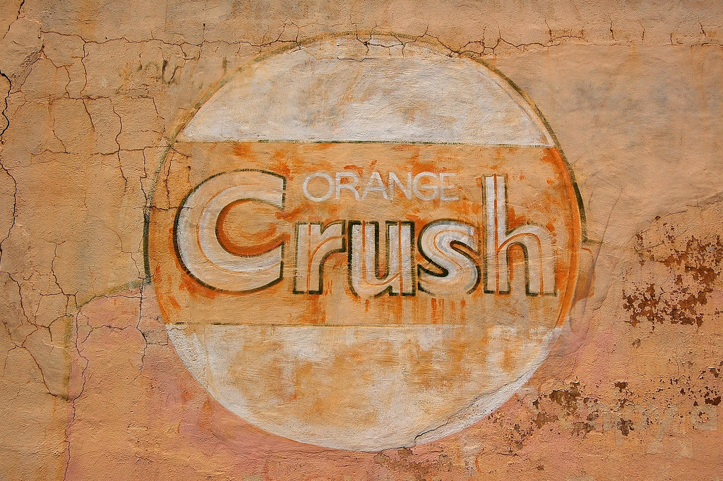 Crawfordville, GA (Taliaferro County). May 2007<br /> <br /> Old Orange Crush mural on the side of Bill's Grocery in Crawfordville, GA (Taliaferro County), taken in May 2007. The building has since been torn down and sadly, the mural no longer exists.<br /> <br /> Orange Crush was a zesty orange drink created in 1916 by Clayton J. Howell and Neil C. Ward. It became so  popular that by 1919, the company was able to pay artist Norman Rockwell to paint print advertising for the leading magazines of the time. but its popularity has declined in the second half of the 20th century.