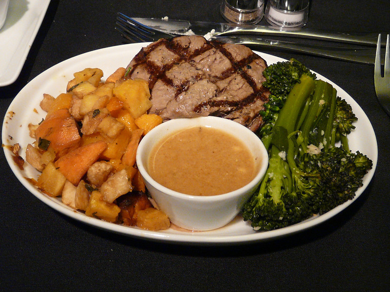 20140122 1800 ORD-LHR Grilled fillet of beef served with foyot sauce, roasted root vegetables and garlic sauteed broccolini