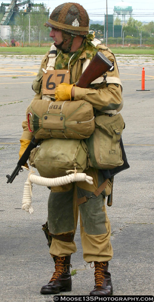A museum volunteer, dressed as a D-Day paratrooper, prepares for a flight on the C-47.