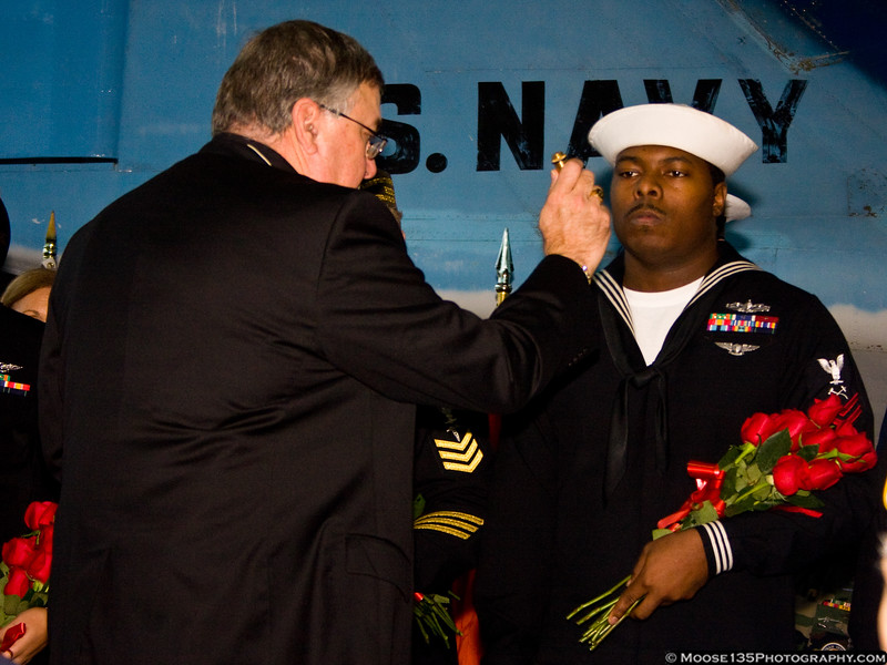 Captain Ronald Klose, Chaplan, US Navy Reserve, blesses roses which will be dropped at the Statue of Liberty