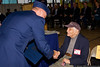 Col. Thomas Owens, Commander of the 106th Air Rescue Wing, greets survivor Seymour Blutt