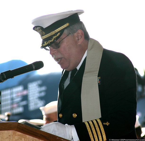 US Navy chaplain reads the invocation.