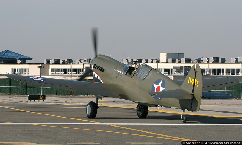 """""""Warbirds over Long Island"""" sent this P-40 to take part in the ceremony."""