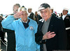 Pearl Harbor survivors Armand Izzo and Seymour Blutt salute the flag during Pearl Harbor Day ceremonies.