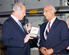 Congressman Israel presents the Congressional Gold Medal to Mr. McRae.