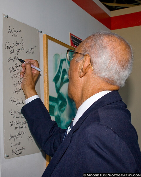 Mr. McRae adds his signature to the museum's Tuskegee Airmen Wall of Honor.