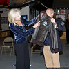Jeff Clyman, AAM president, presents a flight jacket to Rebecca Campbell.