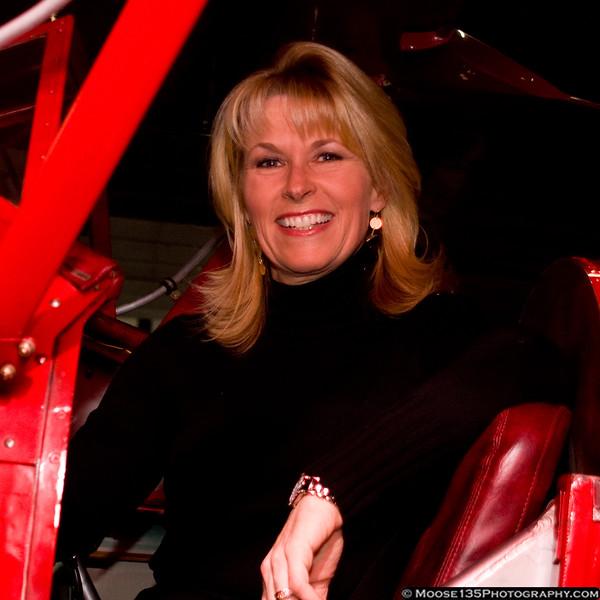 Diana Williams in the cockpit of the museum's WACO.