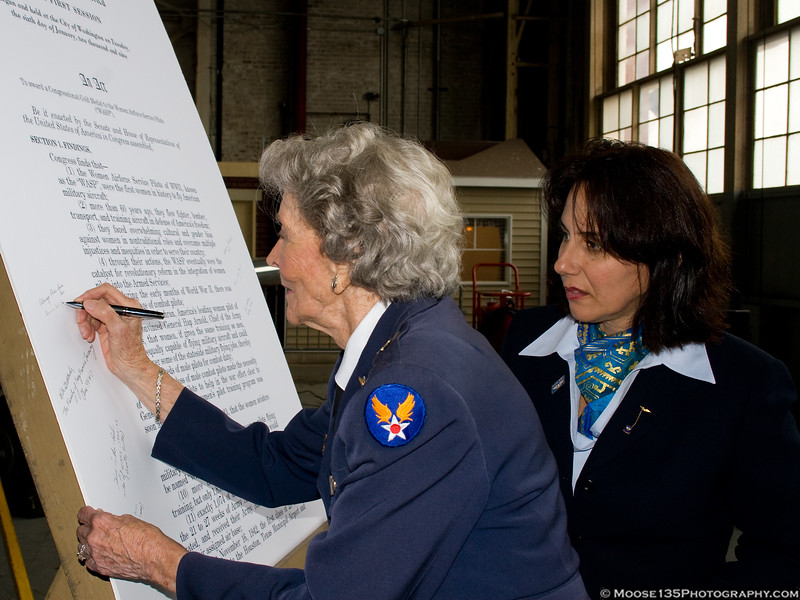 WASP Bernice Haydu signs a copy of the legislation awarding the Congressional Gold Medal to the Women Airforce Service Pilots.