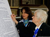 WASP Katherine Willinger signs a copy of the legislation awarding the Congressional Gold Medal to the WASPs.