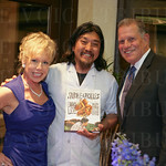 Marcie and Buck Lowe receive a signed copy of Chef Edward Lee\'s book.