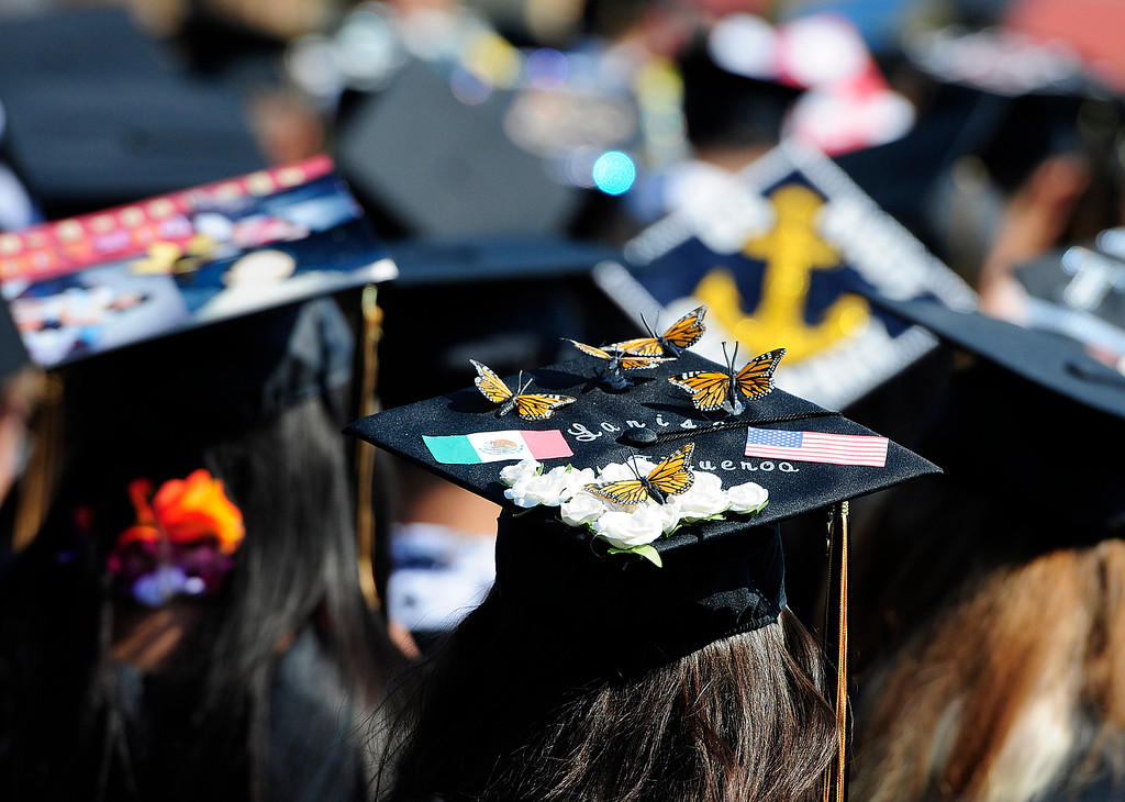 . AMERICAN CANYON, CA - JUNE 6, Butterflies appear to land on a graduate\'s cap during the ceremony at American Canyon High School on Wednesday. (CHRIS RILEY/TIMES-HERALD)