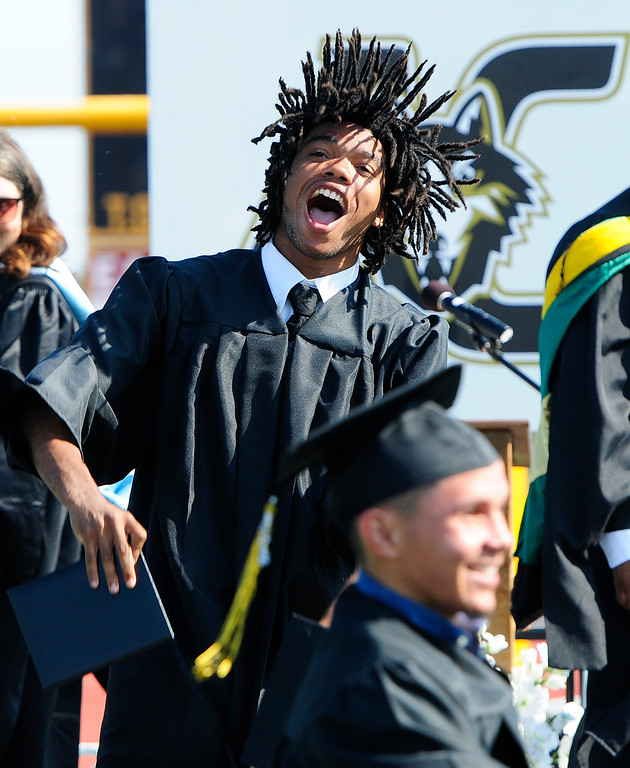. AMERICAN CANYON, CA - JUNE 6, Robbi Brown shakes his dreds as he celebrates while graduating from American Canyon High School on Wednesday. (CHRIS RILEY/TIMES-HERALD)